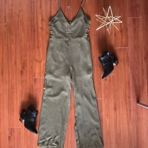 Green jumpsuit with side cut outs